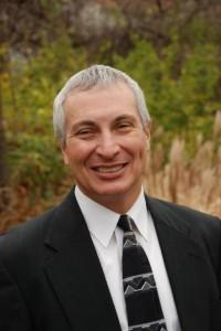 Dr. Dennis W. Atkins, Executive Director
